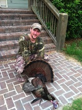 Owner-Barrett Boulware with his first double bearded tom...making this his 53rd bird taken his self