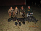 10 pigs and 4 happy hunters